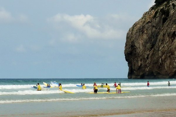 Surfers on Playa de Berria (9km)