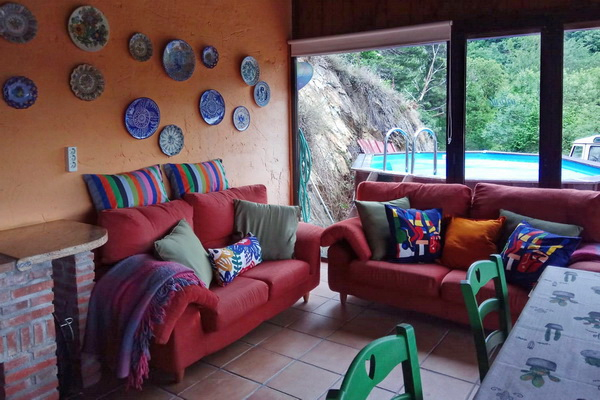 Enclosed gazebo lounge and pool beyond